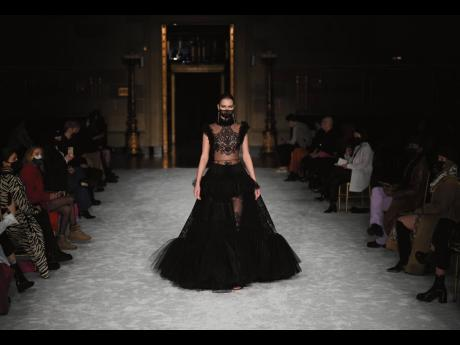 The mask completes this black lace and tulle look.