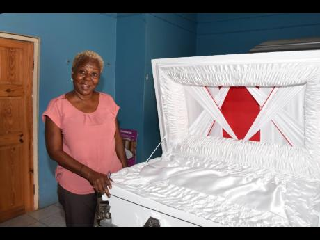 Sonia Lewis, general manager of Lewis Funeral Home in downtown Kingston, is concerned about increased storage costs with burials being banned.