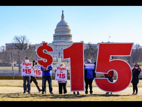 Activists appeal for a US$15 minimum wage near the Capitol in Washington on February 25. The fight is on to attach a hike in the federal minimum wage to the US$1.9-trillion COVID relief bill in the United States.