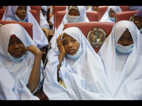 Some of the students who were abducted by gunmen from the Government Girls Secondary School, in Jangebe, last week are seen after their release meeting with the state Governor Bello Matawalle, in Gusau, northern Nigeria, yesterday.