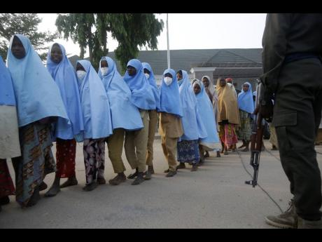 Some of the students who were abducted by gunmen from the Government Girls Secondary School, in Jangebe, last week after their release meeting with the state Governor Bello Matawalle, in Gusau, northern Nigeria, yesterday.