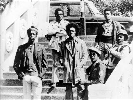Bob Marley and The Wailers (from left) Peter 'Peter Tosh' McIntosh, Aston 'Family Man' Barrett, Bob Marley, Earl 'Wire' Lindo, Carlton 'Carly' Barrett and Neville 'Bunny Wailer' Livingston pose for a portrait in 1973 in London, England.