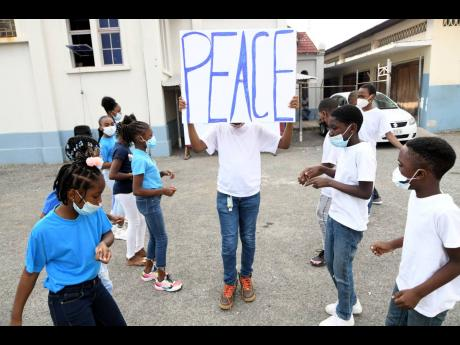 Members of the St Matthew's Optimist Club participate in a Peace Day activity on Tuesday.