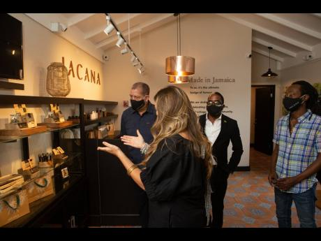 Jacana CEO Alexandra Chong (front) gives Audley Shaw, Norman Dunn and Jesse Royal a tour of the new Jacana location, including the new Original product line.