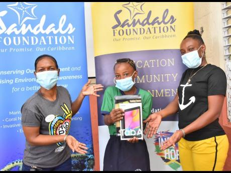 From left: Rochelle Forbes-Reid, public relations manager, Sandals Whitehouse, shares a light moment with Shantae Williams, student at Fyffes Pen Primary School in St Elizabeth, and mother, Dian Channer. The Sandals Foundation continues to distribute more