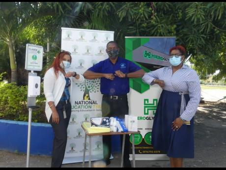 Under these masks are bright smiles in light of the PPE donation to the Central Branch All-Age School. Sharing lens in this warm moment are (from left) Shirley Moncrieffe, director of educational projects at the National Education Trust; Michael Sutherland