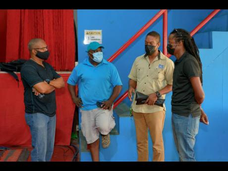 From left: Rohan Amiel, Delroy Johnson, Roy Meikle and Gareth Daley discuss setup ahead of the virtual staging of the Jamaica Jazz and Blues Festival. The festival gets started tonight and ends on Saturday.