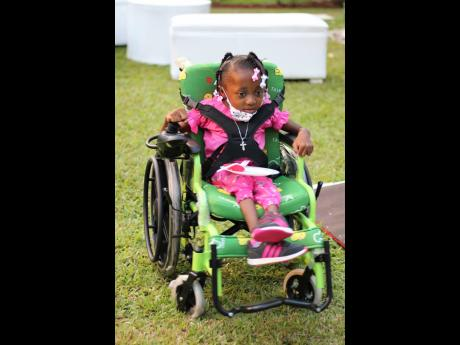 Dominique Smith quickly learnt how to operate her new, motorised chair around the garden.