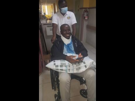 Tainee pastor Marvin Pryce days after his surgery to repair a herniated disc at the Andrew's Memorial Hospital.