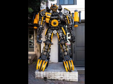 A sculpture of Transformer Bumblebee is seen at the entrance of Georgetown University biochemistry professor Newton Howard's home.