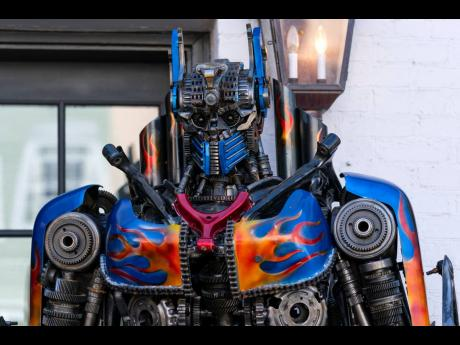 INSET: The face of a sculpture of Transformer Optimus Prime is seen at the entrance of Georgetown University biochemistry professor Newton Howard's home.