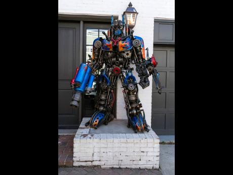 RIGHT: A sculpture of Transformer Optimus Prime is seen at the entrance of Georgetown University biochemistry professor Newton Howard's home.