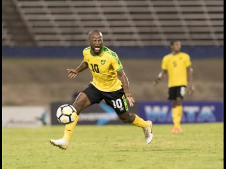 Jamaica's Javon East reacts to a call by the referee in the Jamaica vs Aruba match during the Concacaf Nations League at the National Stadium in Kingston, Jamaica, on Saturday, October 12, 2019.