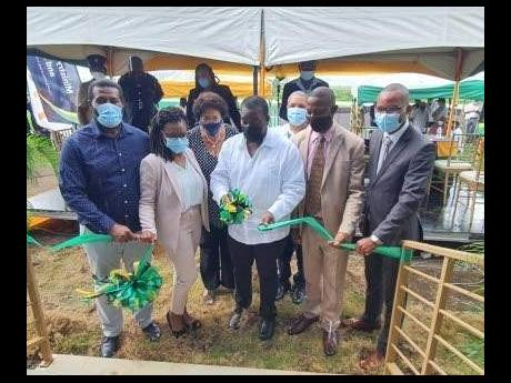 Transport and Mining Minister Robert Montague (centre) officially opens the new  fire station at the Negril Aerodrome  in Westmoreland.  Others (from left) are Eastern Westmoreland Member of Parliament Daniel Lawrence; Western Hanover Member of Parliament