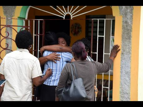 The family of 24-year-old Cody McLaughlin mourns his death at the family home in Duncans Pen, St Catherine.