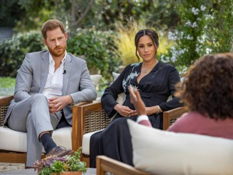 Prince Harry (left), and Meghan, Duchess of Sussex, in conversation with Oprah Winfrey. 'Oprah with Meghan and Harry: A CBS Primetime Special' aired last night on CBS.