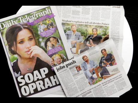 Australian newspapers report in Sydney, Tuesday, March 9, 2021, on an interview of The Duke and Duchess of Sussex by Oprah Winfrey.
