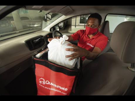 A member of the QuickPlate team makes a delivery. The food-delivery service now employs approximately 40.