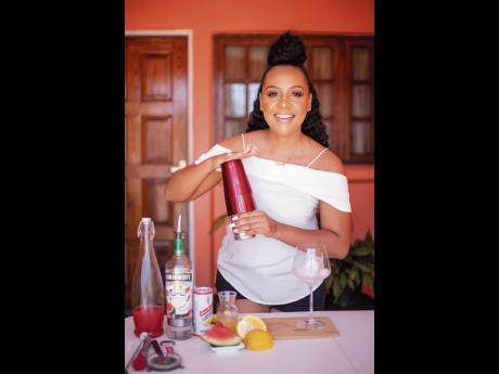 Mixologist Nicolina Diabo gives her Red Stripe Watermelon Spritzer a good, quick shake.