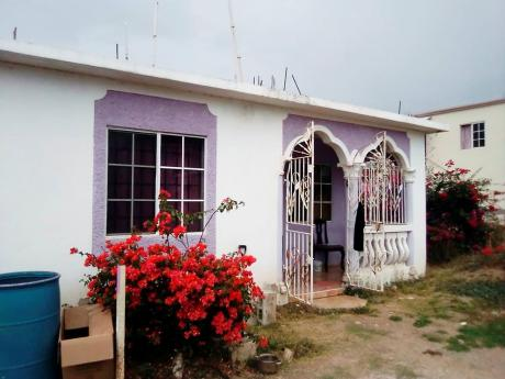 The Greater Portmore home where 52-year-old Dalbert Edwards was stabbed on Monday night, allegedly by his 21-year-old son.