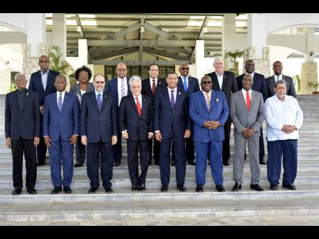 President of Chile Sebastian Pinera (fourth left), with the 15 regional leaders for an official photo during 39th Regular Meeting of CARICOM Heads of Government at the Montego Bay Convention Centre in 2018.