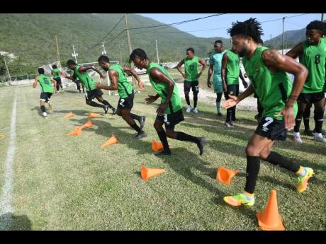 Members of Jamaica's national senior football team go through a training exercise at The University of West Indies/Jamaica Football Federation/Captain Horace Burrell Centre of Excellence in 2019.
