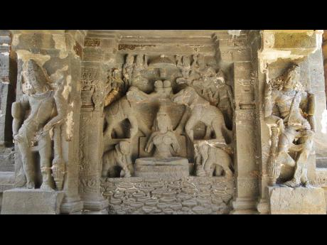 Statues carved on the walls of the caves in  Ellora