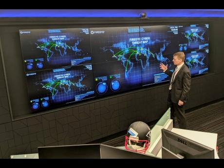 The CEO of FireEye, Kevin Mandia, gives a tour of the cybersecurity company's unused office space in Reston, Virginia, on Tuesday, March 9.