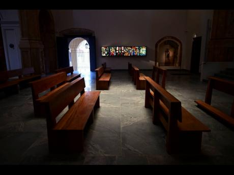 Pews stand in the San José Church as it reopens after reconstruction in San Juan, Puerto Rico. The second oldest in age only to the Spanish cathedral in the neighbouring Dominican Republic, it was shuttered in 1996 due to serious deterioration.