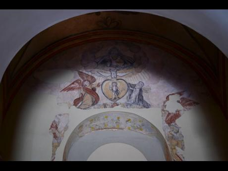 Details of a centuries-old mural are preserved inside San José Church.