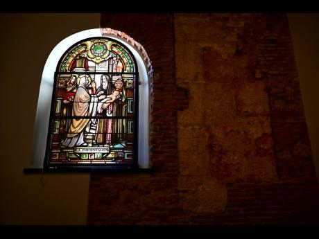 A stained glass window stands inside the San José Church.