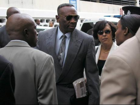 File  Senior Superintendent of Police Reneto Adams (centre) leaves the Home Circuit Court on January 17, 2005 after turning out to support his colleagues charged with the Braeton Seven murders.