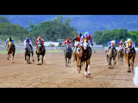 CUSTER, ridden by Shane Ellis (foreground), outpaces rivals and wins the sixth race at Caymanas Park on Sunday, March 7, 2021.