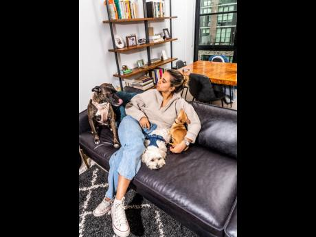 Minali Chandiram, co-founder of Wild One, shares lens time with some dogs wearing her branded products.
