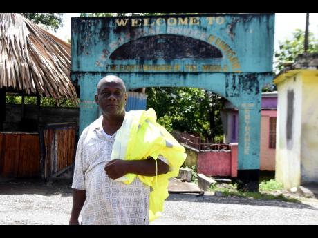 Noel Bennett, president of the community development committee in St Catherine, stands at the entrance to a walkway that takes visitors to the bottom of a natural bridge in Riversdale. He hopes to resurrect the stillborn dream of the bridge as an ecotouris