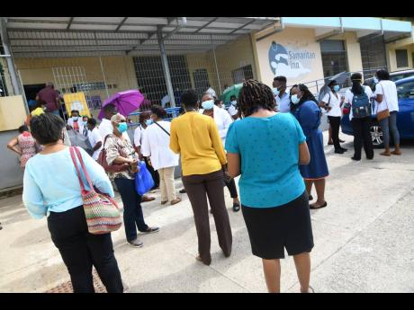 Private healthcare workers and the elderly waiting to be vaccinated at the Good Samaritan Inn in Kingston yesterday.