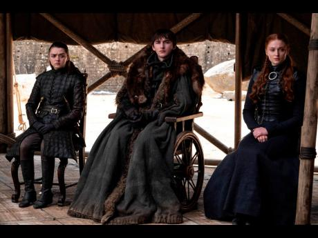 From left: Maisie Williams, Isaac Hempstead Wright and Sophie Turner in a scene from the final episode of 'Game of Thrones'.