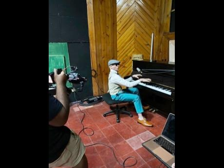 King Yellowman plays the piano during the recording of his music video for 'Kiss me each Morning'.