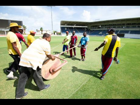 Groundsmen prepare a pitch at Sabina Park ahead of a Test match between the West Indies and India in August 2019.