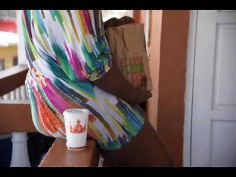 A woman eats fast food on Tuesday. Obesity has been cited as a trigger of several non-communicable diseases.