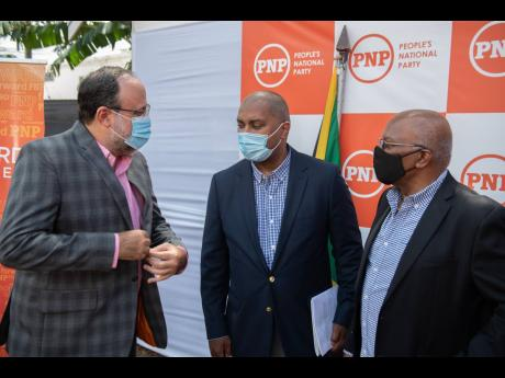 From left: Opposition Leader Mark Golding converses with Spokesperson on Finance Julian Robinson and the spokesperson on health, Dr Morais Guy, following a post-Budget Debate media briefing, held at the office of the leader of the Opposition in St Andrew o