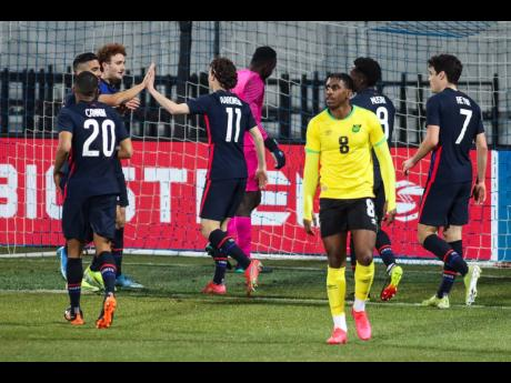 USA players celebrate after scoring their second goal during the international friendly soccer against Jamaica at SC Wiener Neustadt Stadium in Wiener Neustadt, Austria on Thursday afternoon.
