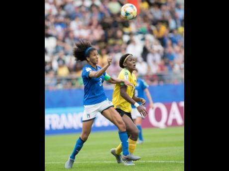 Khadija Shaw (right) of Jamaica and Italy's Sara Gama compete for possession of the ball in the Jamaica vs Italy fixture in the FIFA Women's World Cup 2019 at Stade Auguste-Delaune in Reims, France, on Friday June 14, 2019. Jamaica suffered a 5-0 loss at t