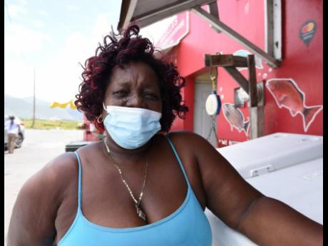 Julett, a fish vendor at the Rae Town Fishing Village in Central Kingston, says the weekend curfews are hurting the business.