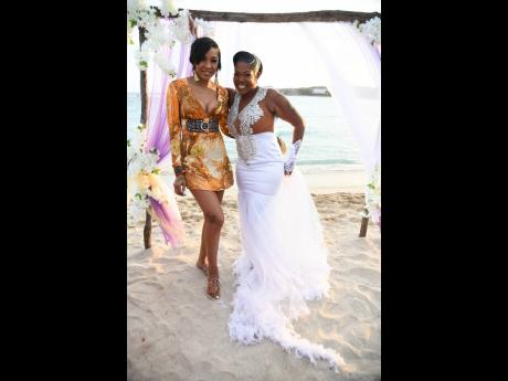 Queenie's NashWear wedding dress was made in less than three days. The happy bride poses with friend and musical collaborator, D'Angel.