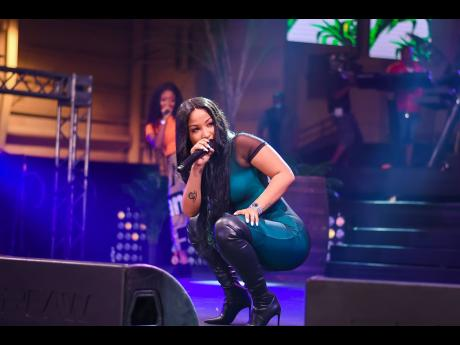 Dressed in a skin-tight emerald green jumpsuit and black high-heel boots, Shenseea performed with finesse.