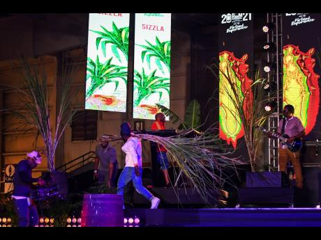 Exiting the Jamaica Rum Festival Concert stage to the tune of 'Take Myself Away', Sizzla brought with him stalks of sugar cane.