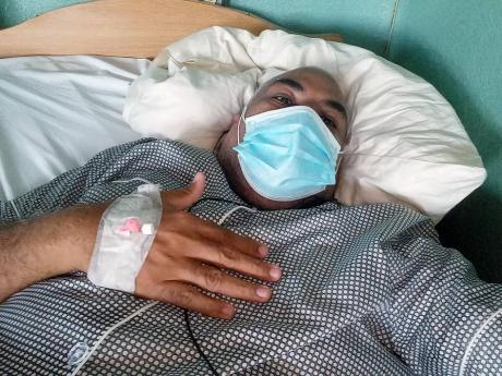 Edward Chin-Mook while he was admitted at the National Chest Hospital. He has urged everyone to invest in an oximeter to check blood-oxygen levels.