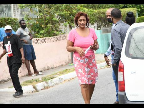 Eunice Chambers, mother of Khanice Jackson, is seen outside her Independence City home shortly after learning of her daughter's murder.