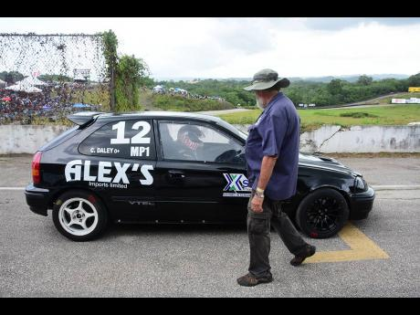 Peter Moodie Sr gives team member Collin Daley Jr one last check before leaving the grid at Dover Raceway.